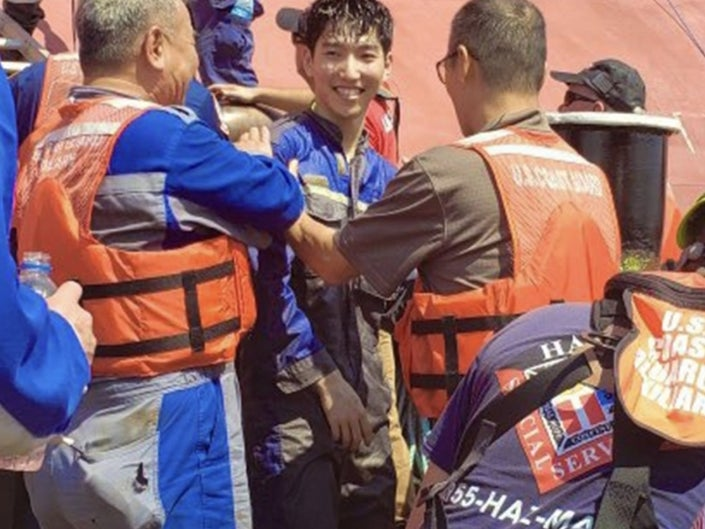 rescuers pulled four trapped men alive from Georgia capsized ship