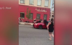 At least two demonstrators were struck as a car hits protesters in Bloomington.